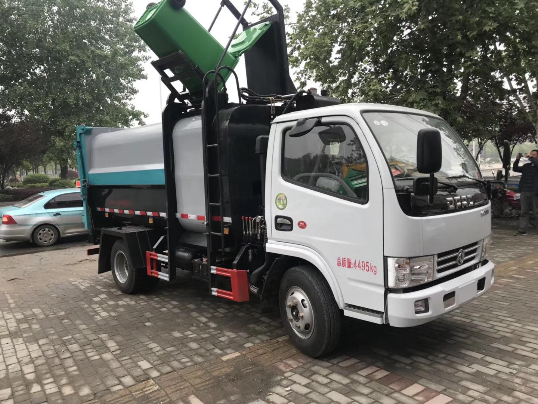 东风小多利卡蓝牌侧装挂桶压缩垃圾车容量大至8方专业定制图片